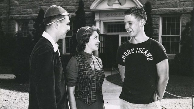 Three students in front of Quinn Hall circa 1950