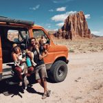 Photo of Brianna Madia with her husband, Keith, dogs, Bucket and Dagwood, and Bertha—the van they call home.
