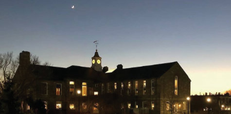Brandon Fuller photograph of the moon over Green Hall