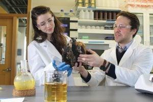 Matthew Bertin, assistant professor of biomedical and pharmaceutical sciences,  and graduate student Riley Kirk