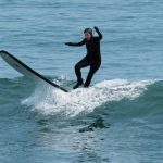 Barbara Caron, editor-in-chief learning how to surf