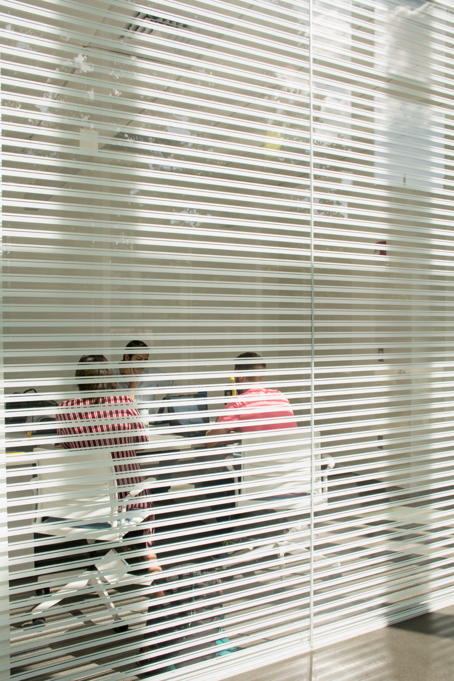 A view inside a classroom through closed blinds
