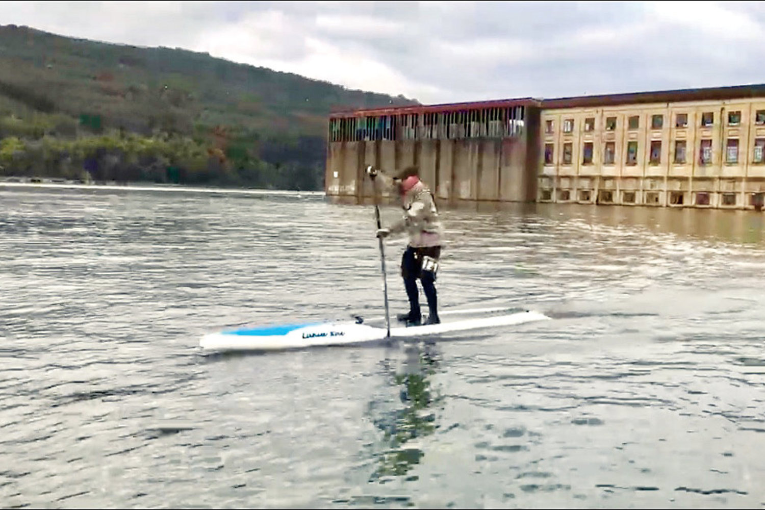 Michael Dunlap participating in the Chattajack paddle race on a stand-up paddle board