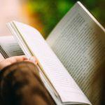 A person reading an open book