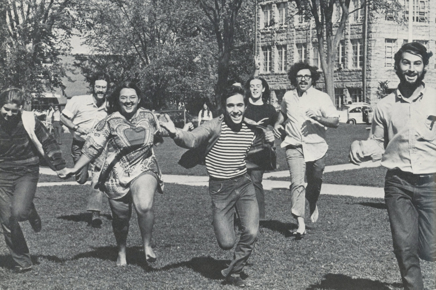 Students run across the quad in a picture from the 1970 yearbook