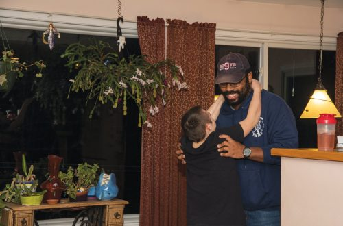An affectionate moment between siblings as two brothers embrace