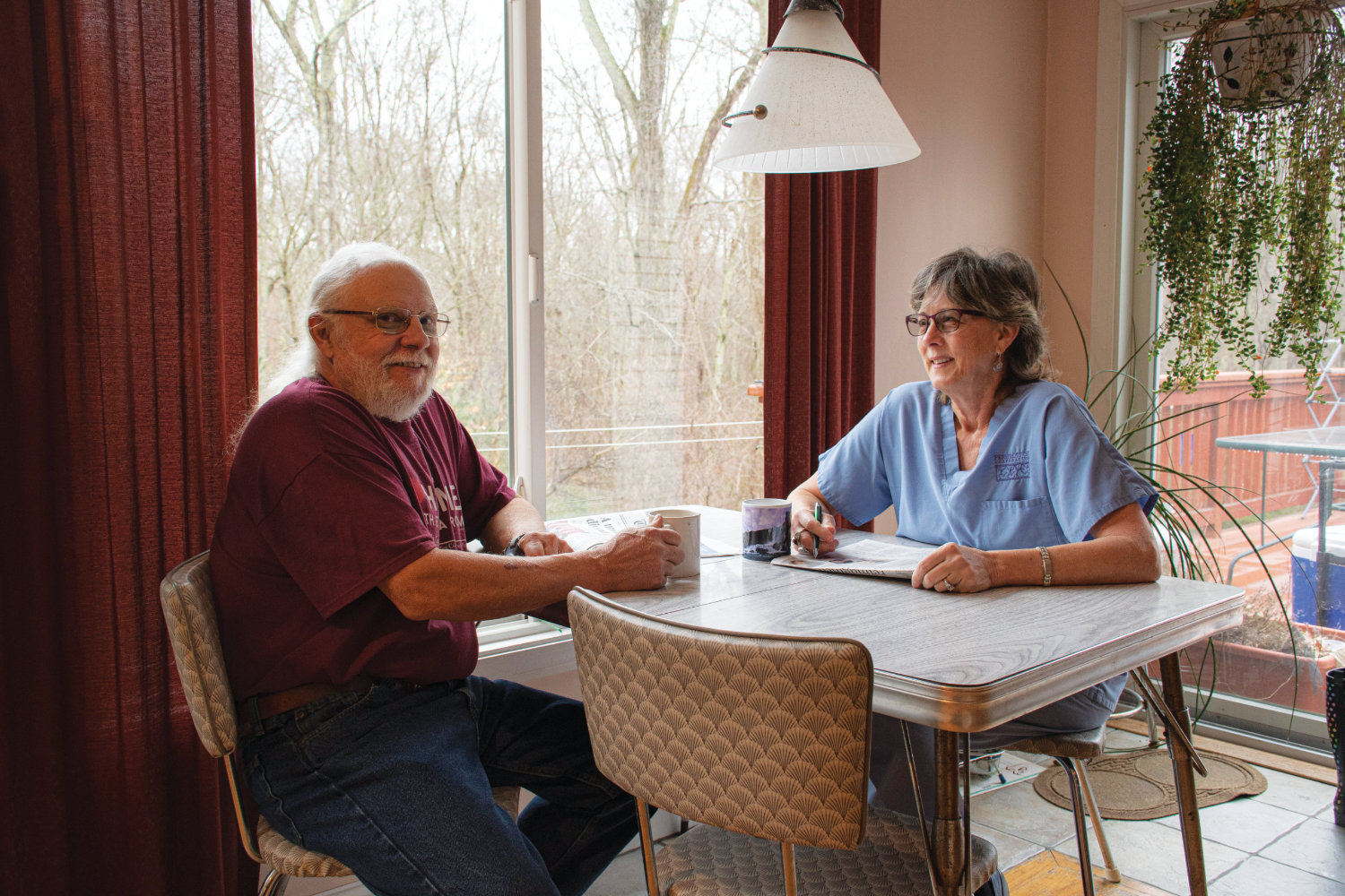 Marc McGiveney '92 and Deb Harbin '92 sitting at their kitchen table
