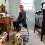Barbara Caron in her home office with her dog, Hammy