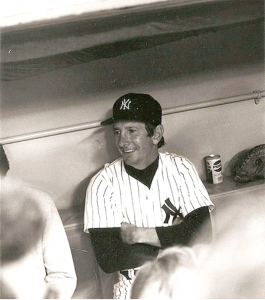 Billy Martin relaxing in the dugout before the 1977 World Series