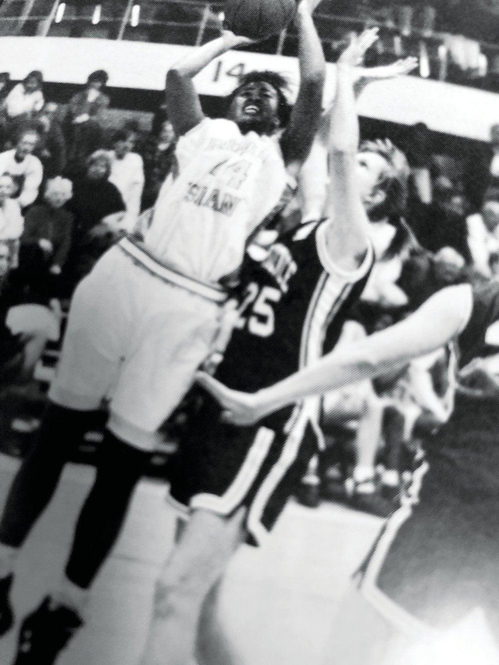 Monica Barnes taking a shot during a URI basketball game
