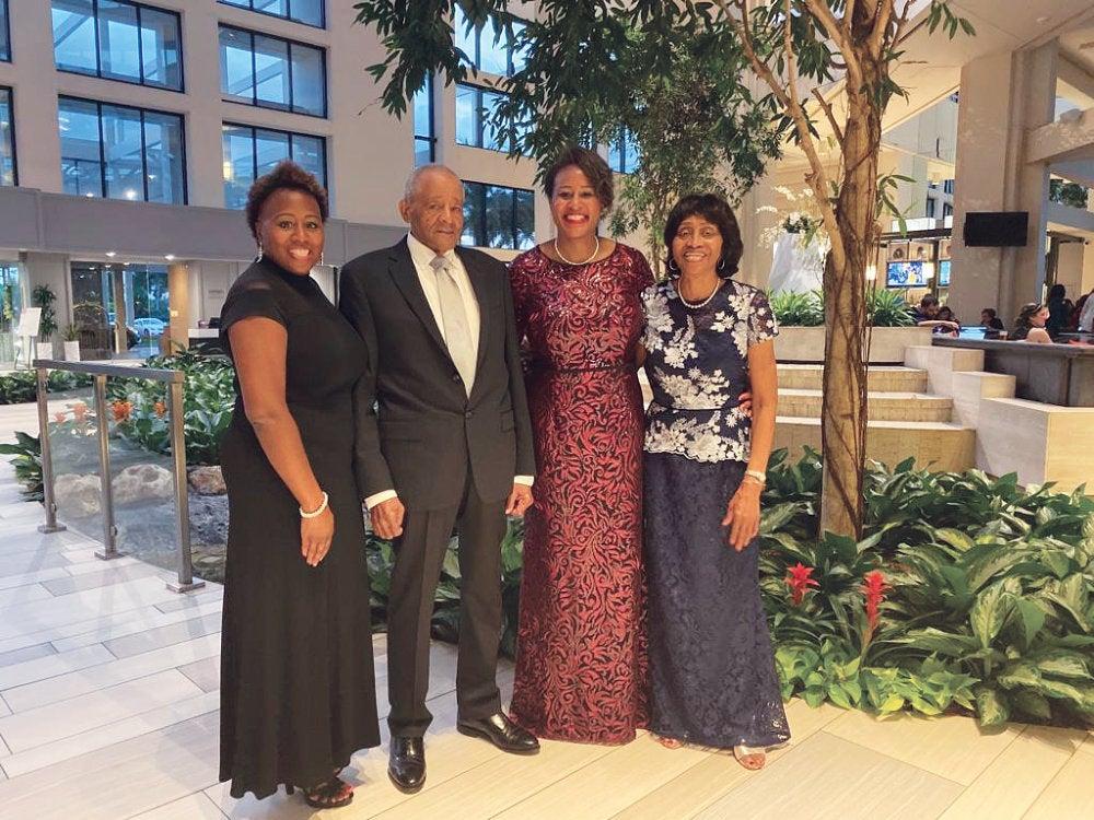 Monica Garnes and her family in formal attire