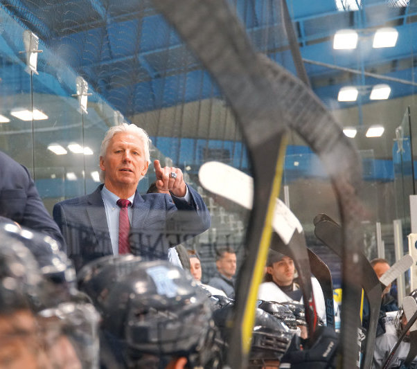URI Hockey Coach Joe Augustine, behind a plexiglass partition