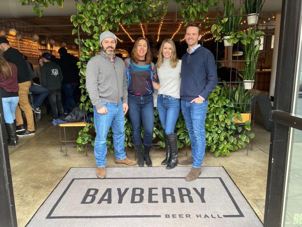 Adam Oliveri, Felice Friedman, Meghan Ferguson, Bryan Ferguson standing together near a carpet with the word Bayberry