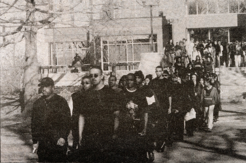 Students, led by Black student group Brothers United for Action, march in protest against a cartoon published in The Good Five Cent Cigar