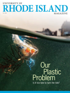 The Cover of the Fall 2020 University of Rhode Island Magazine showing an image of plastic floating in the ocean, with the Narragansett Towers in the background. Feature article text: Our Plastic Problem Is it too late to turn the tide?