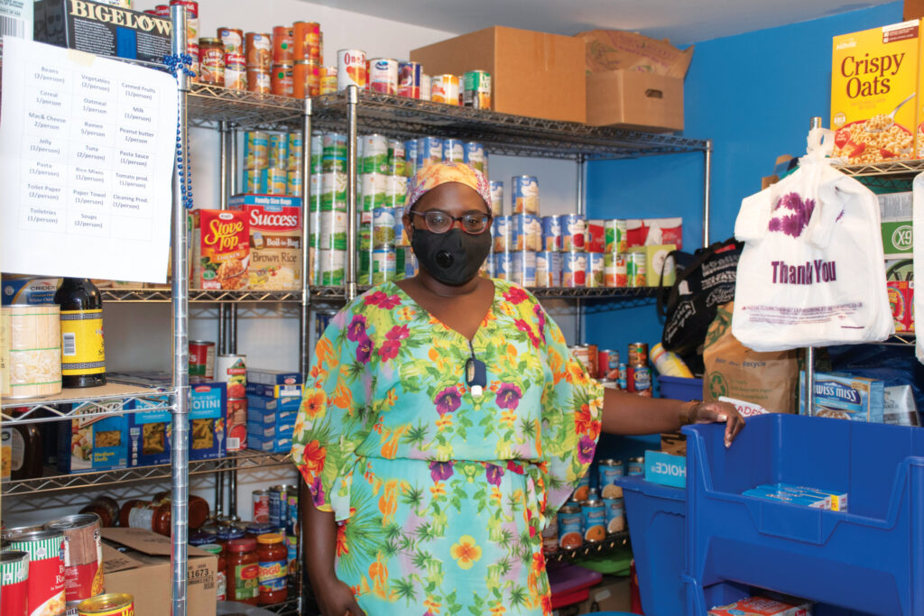 Jacqui Tisdale wearing a mask inside the Rhody Outpost food pantry