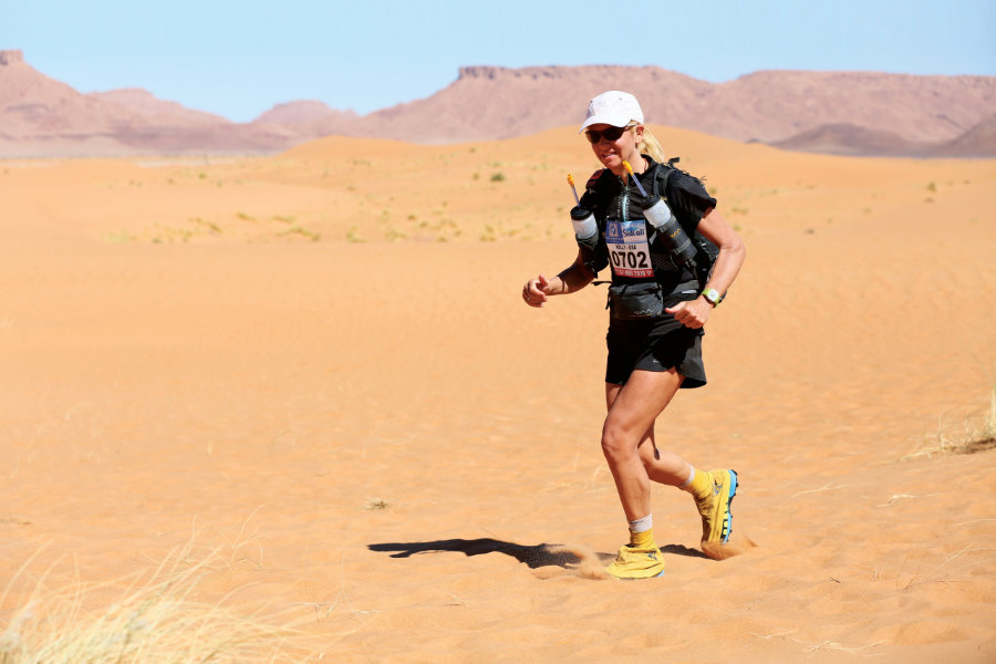 Holly Zimmermann, M.S. '93 running in the desert during the Marathon des Sables distance race