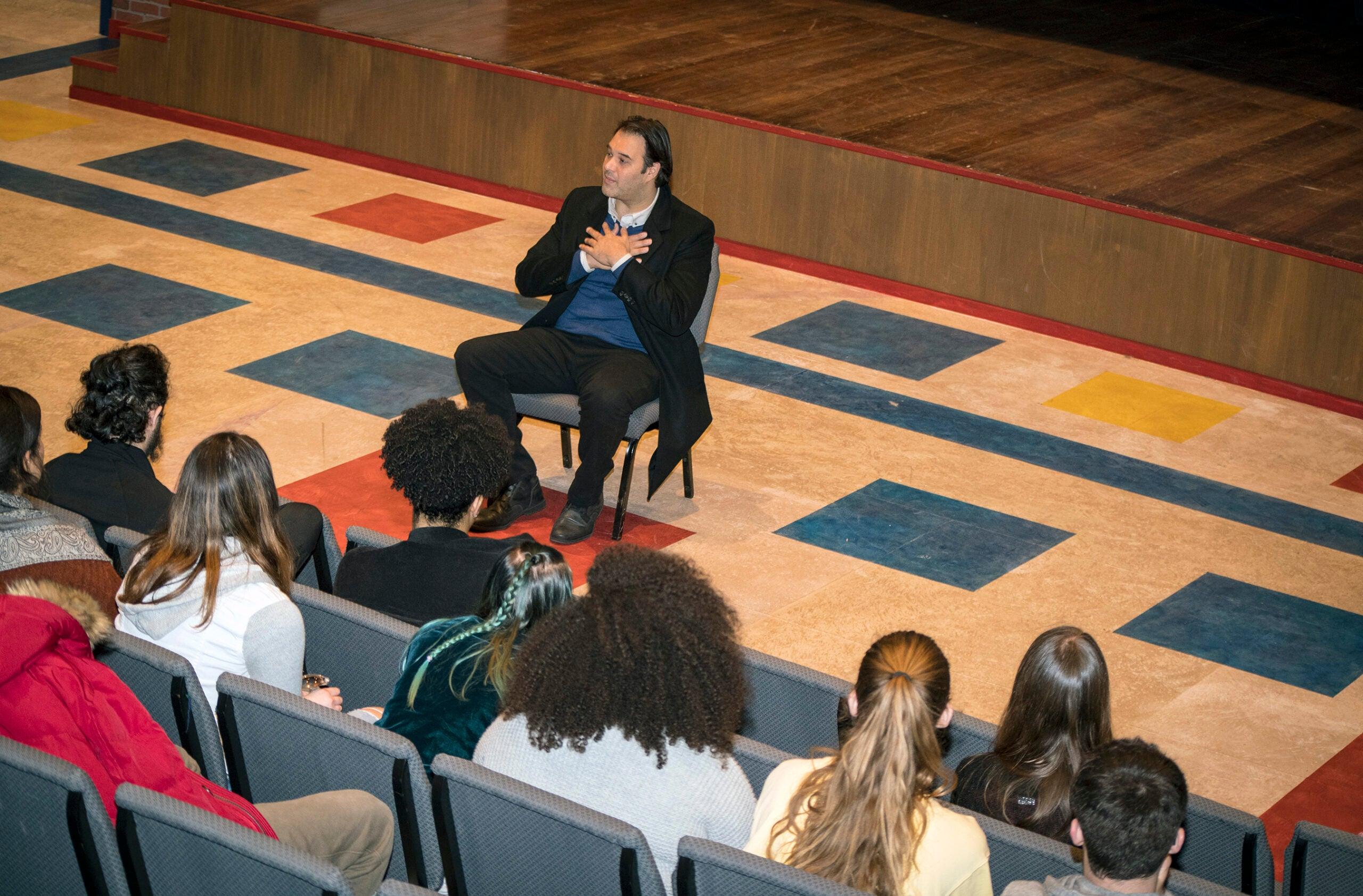 Erick Betancourt talks with URI theater students