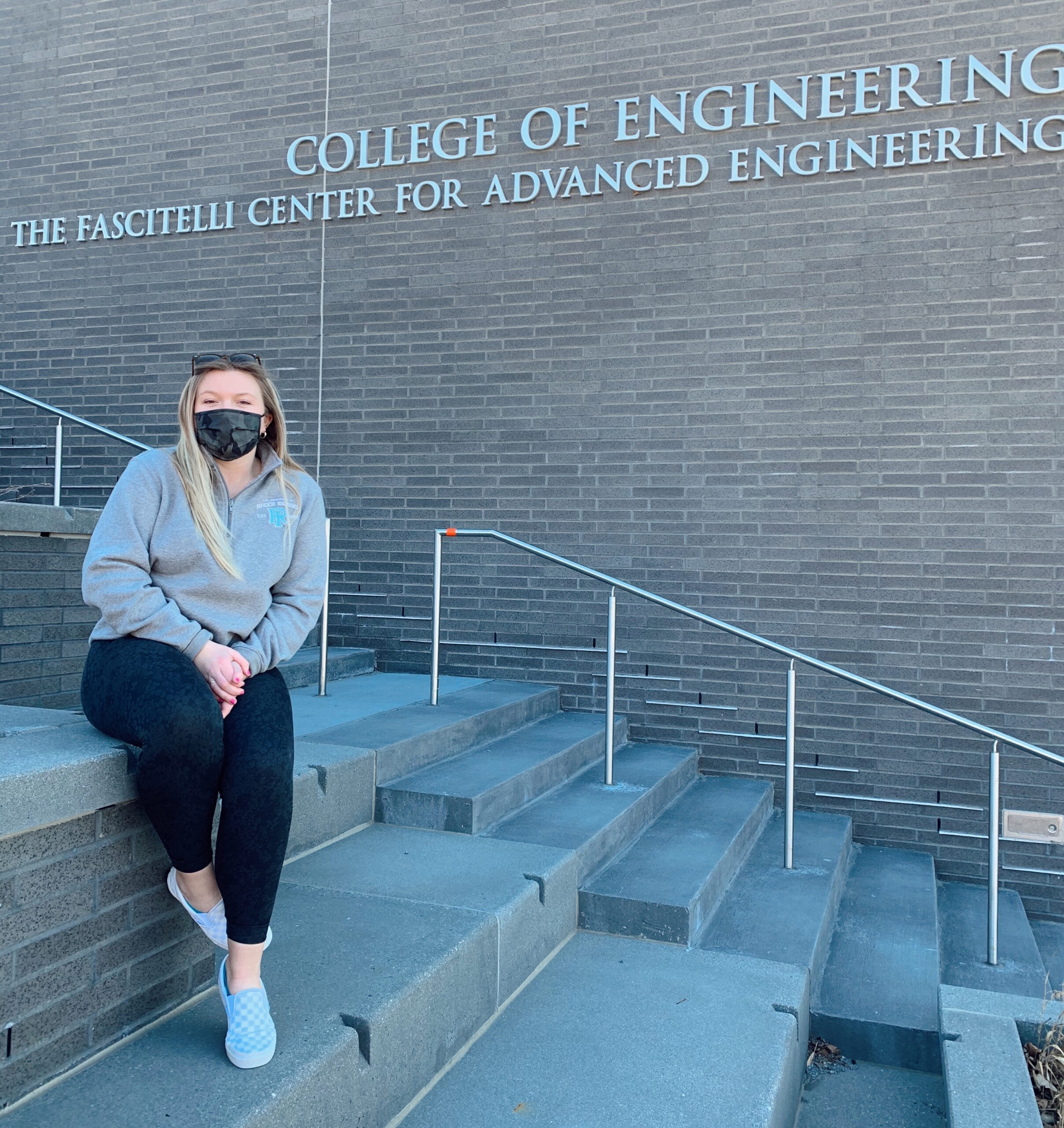 Faith Leonard on the steps outside of The Fascitelli Center for Advanced Engineering at URI