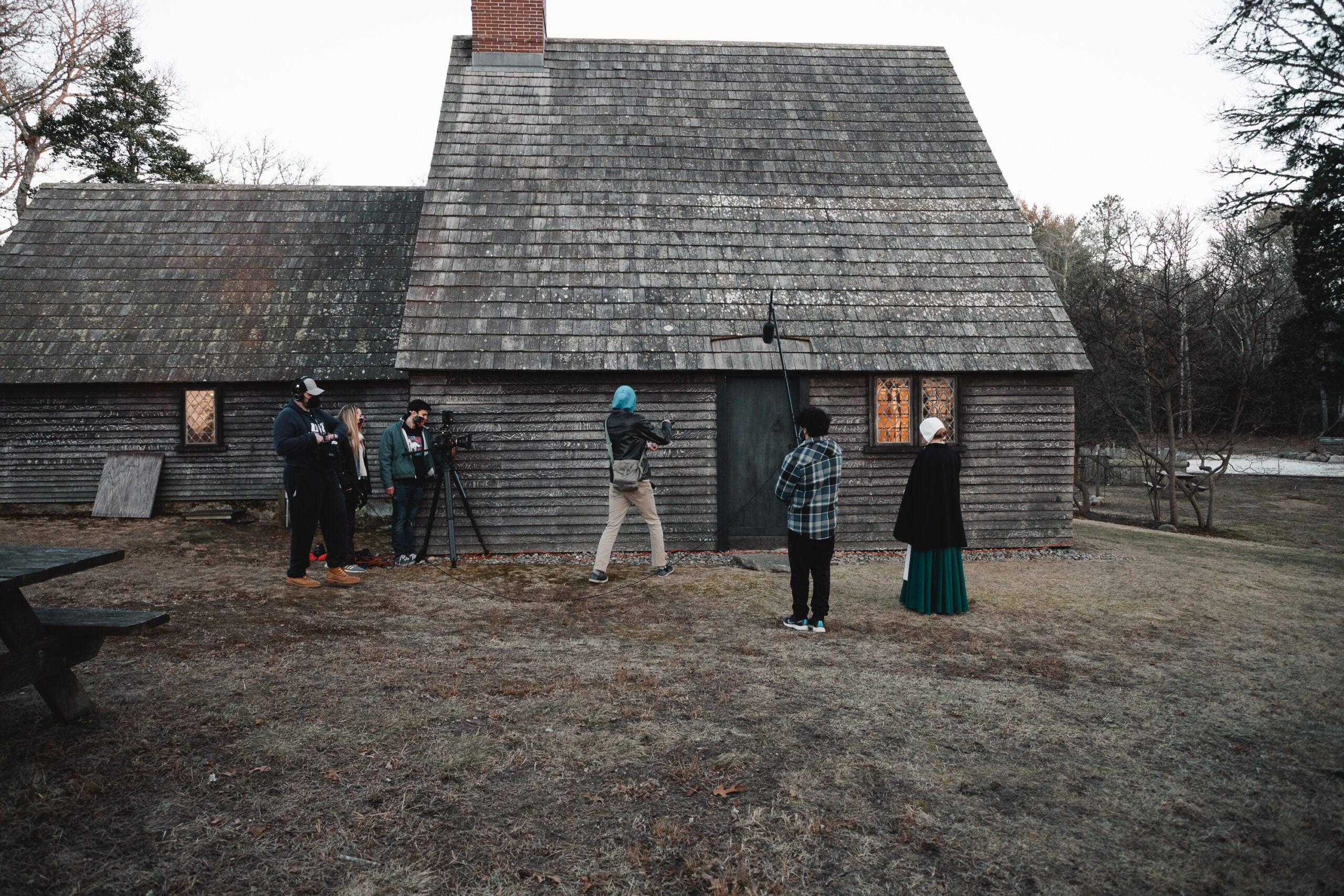 "Crew for ""To Dust All Return"" prepare to film a scene outside the Aptucxet Trading Post in Bourne, Massachusetts. (Photo by Jordan Delisle)"