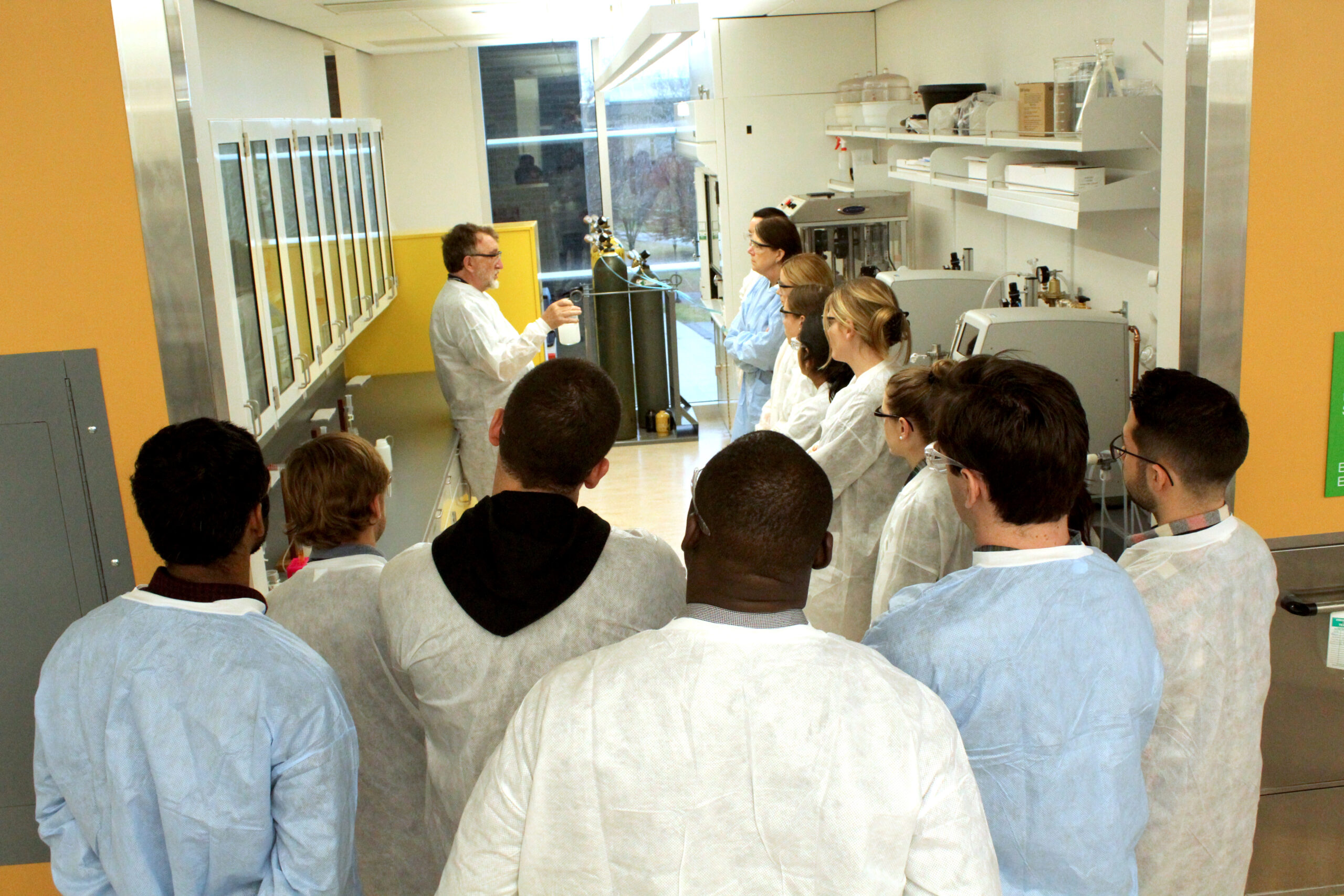 Malcolm Pluskcal leads Amgen employees through a training session