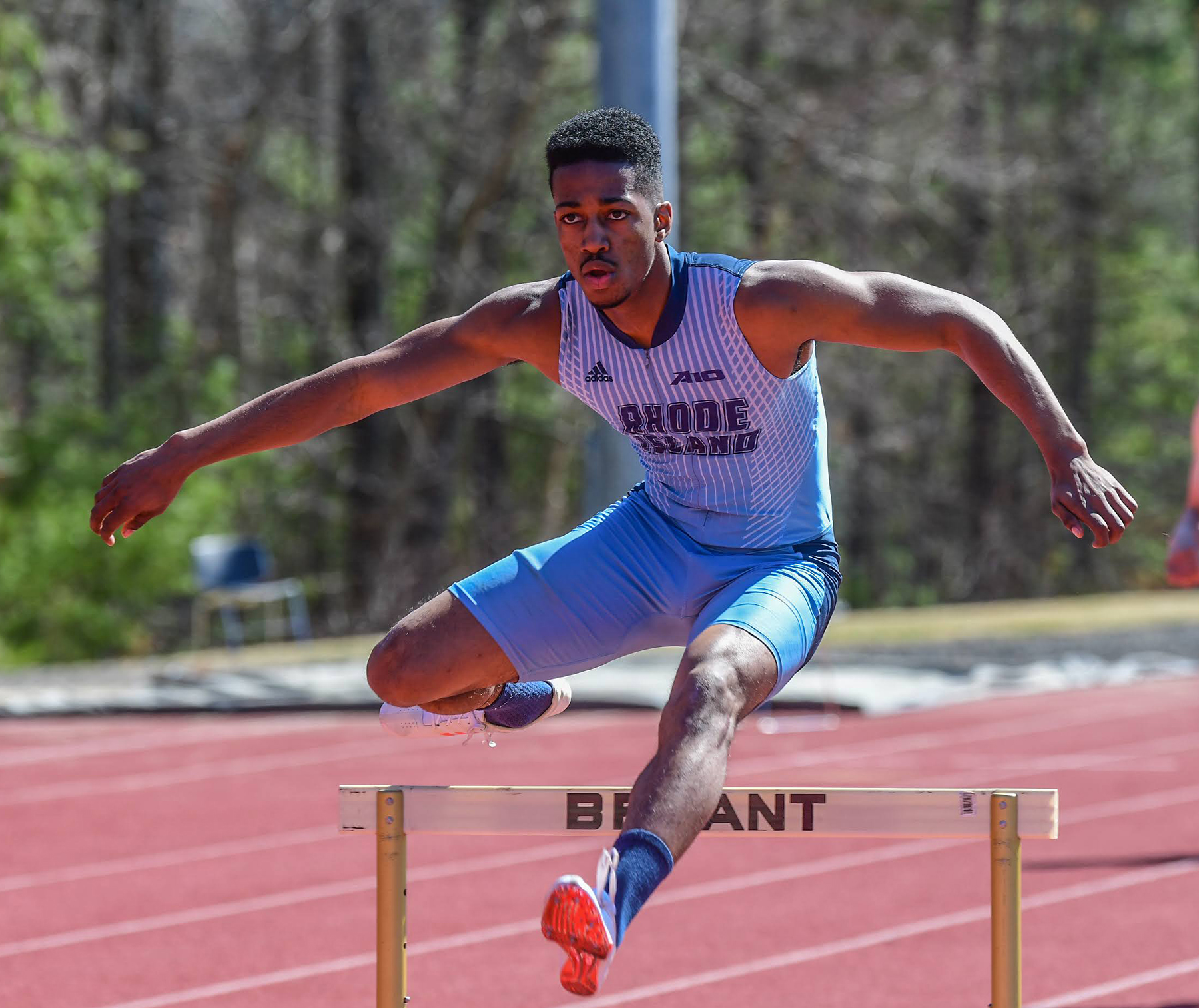 Dickens competes in the 400-meter hurdles