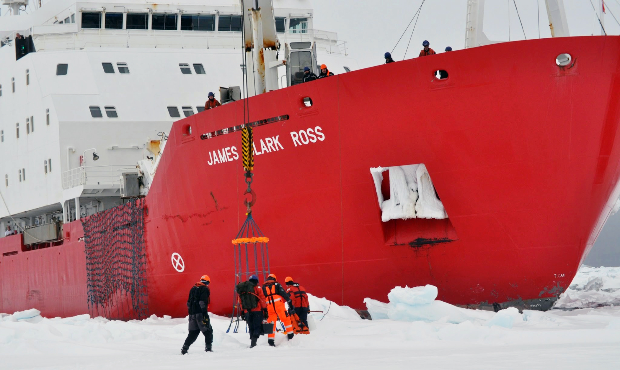 Scientists work alongside the icebreaker, the RRS James Clark Ross, in Antarctica in February 2014. (Photo courtesy of Brice Loose)