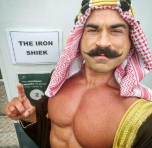 Brett Azar as The Iron Sheik
