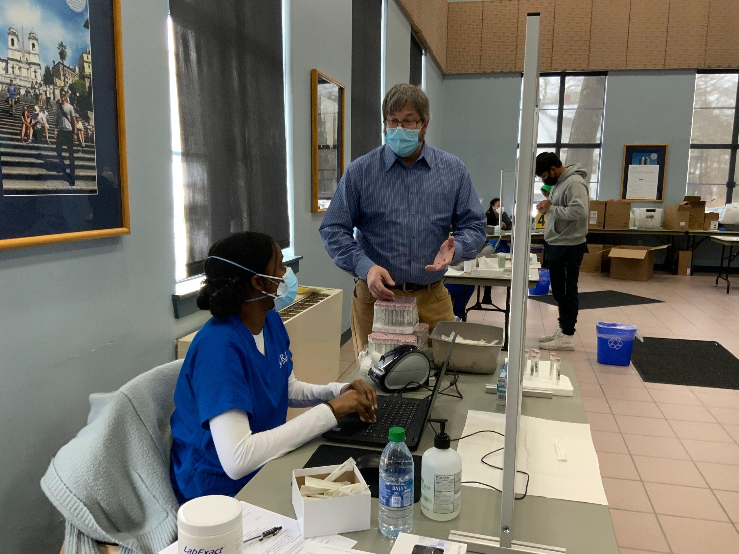 Dan Moos brings supplies to senior nursing student Ashley Philibert