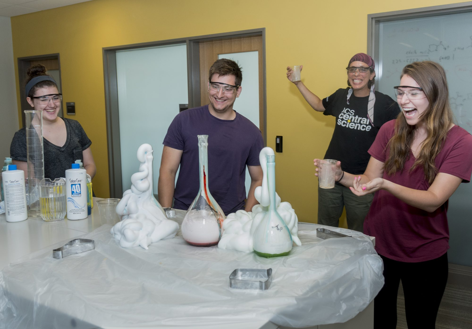 """Mindy Levine and students prepare """"elephant toothpaste."""""""