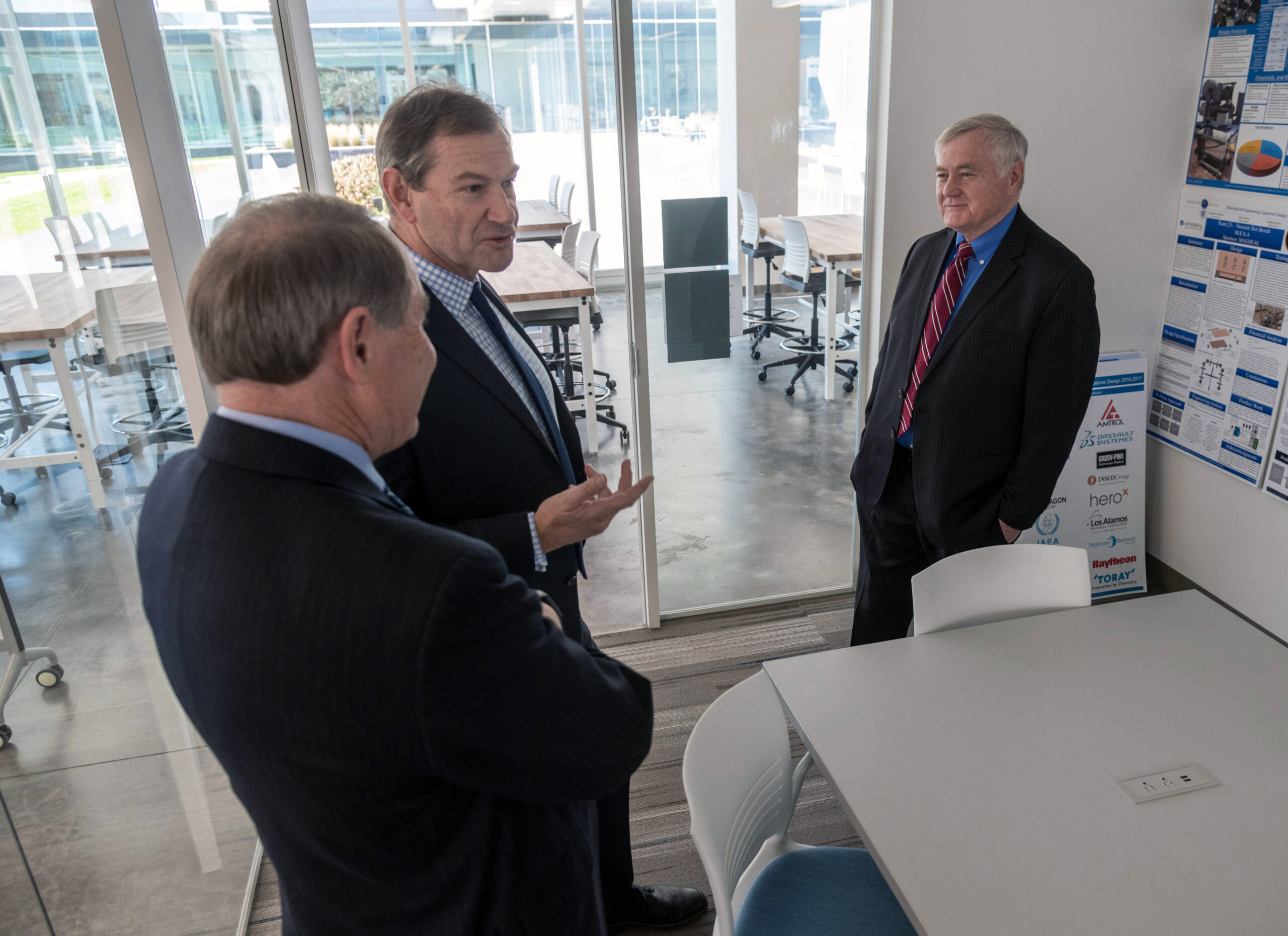 Hexagon's Angus Taylor, center, with URI President David M. Dooley, left, and Dean of Engineering Ray Wright, at URI.