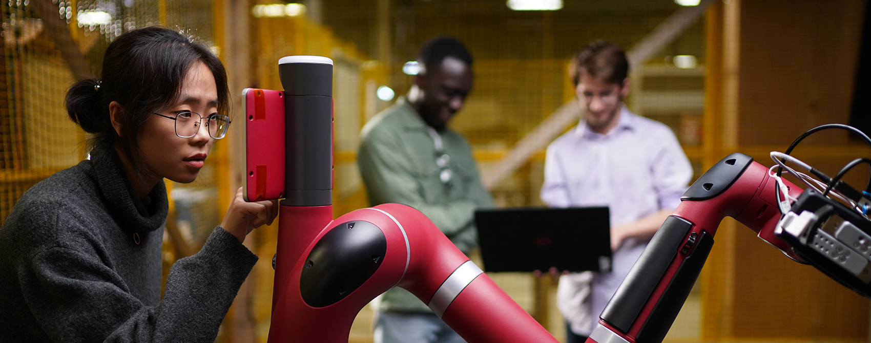 Students work with Robot in engineering lab. Photo credit: Steer