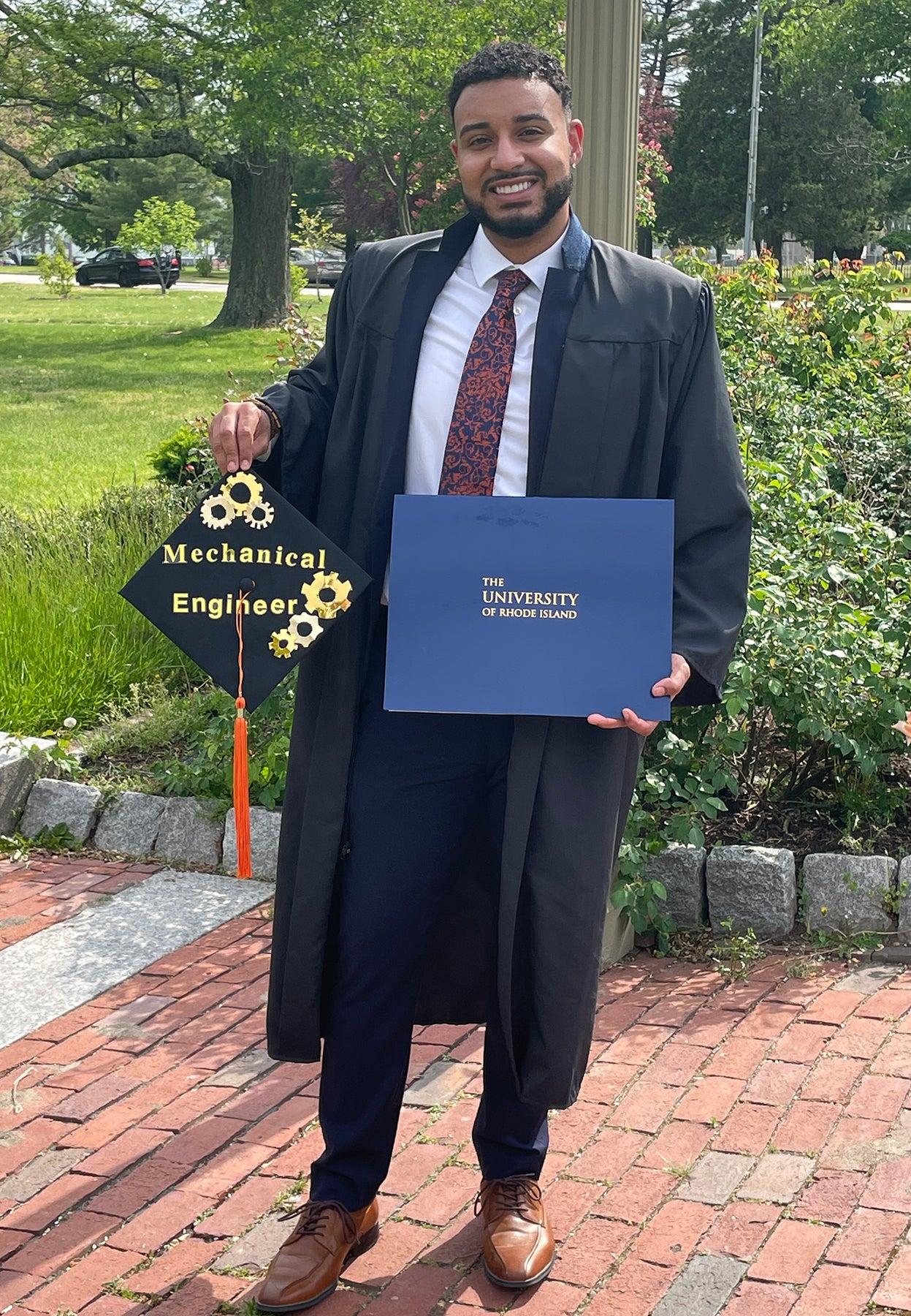 Jeancarlos Nolasco proudly displays his diploma