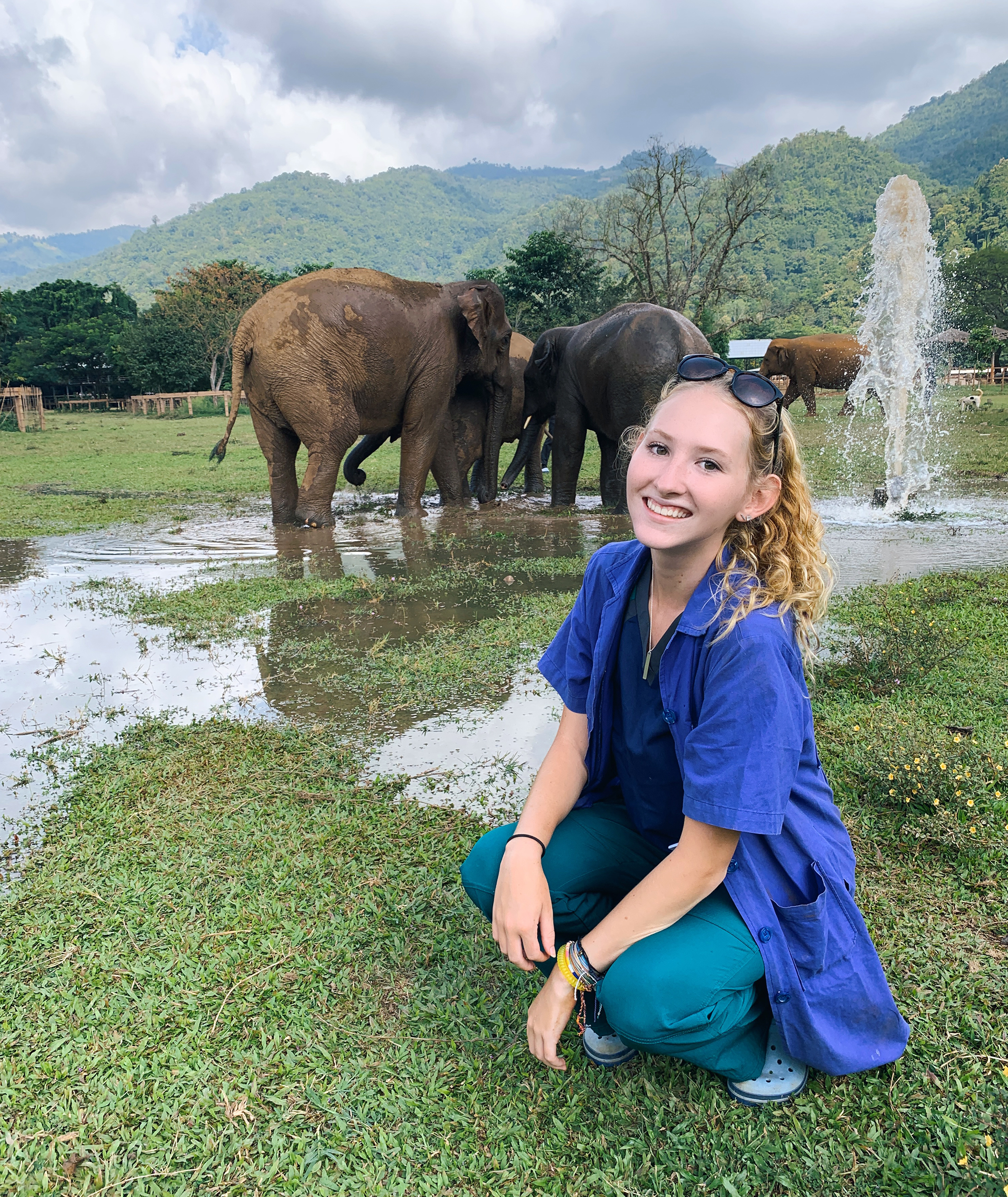 Sydney Page poses at an elephant sanctuary in Thailand