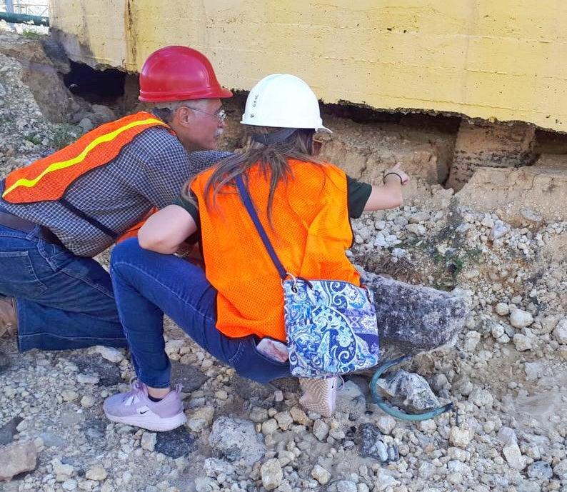 Alesandra Morales-Vélez checks out the damage to a building