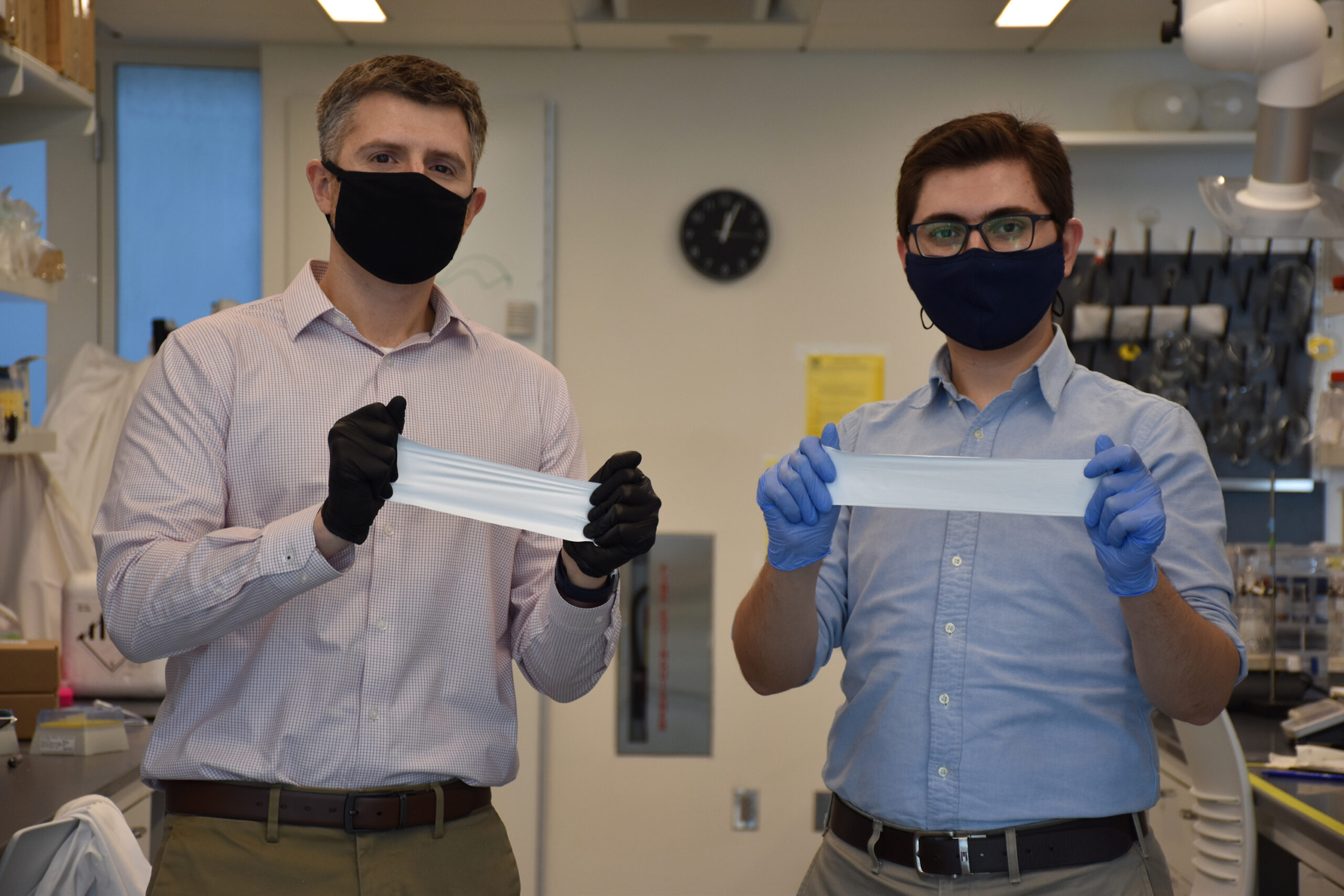 Daniel Roxbury and Mohammad Moein Safaee hold microfibrous materials