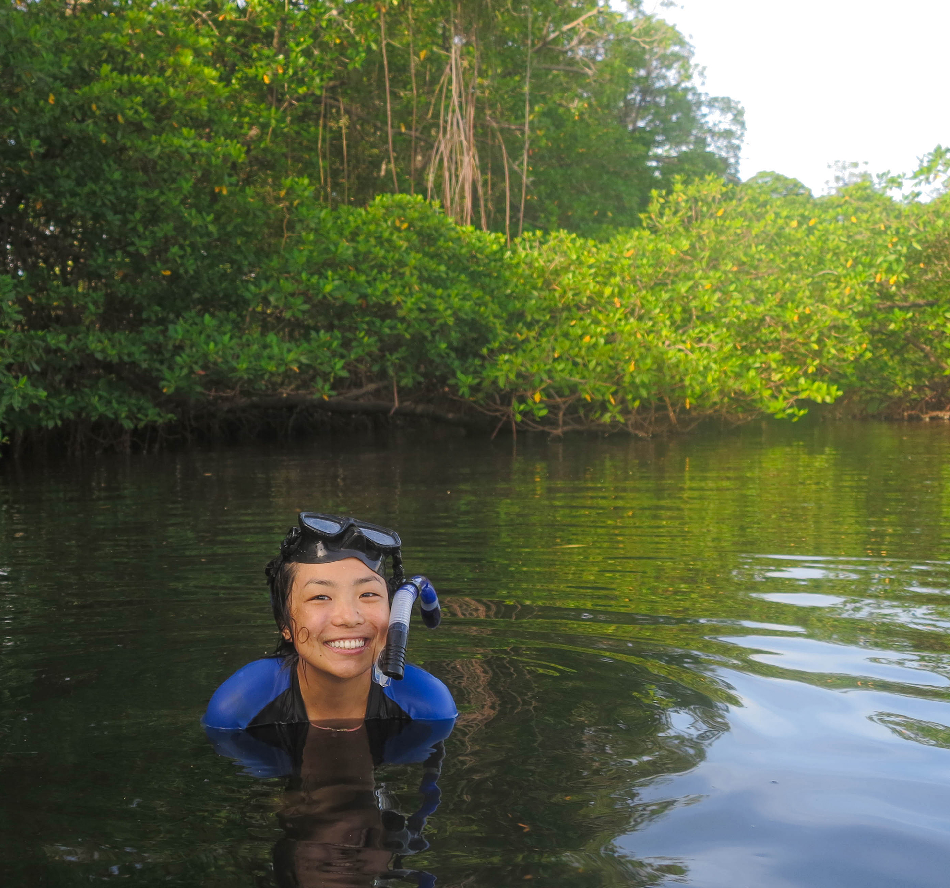 Elaine Shen snorkels in a lagoon in Indonesia.