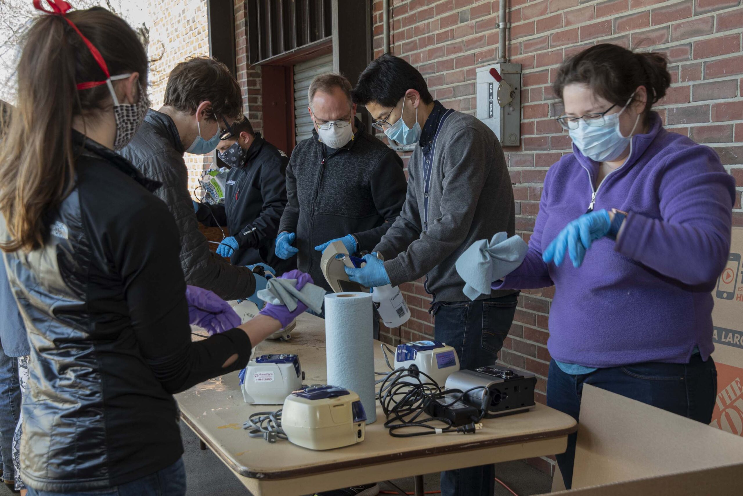 More than 60 volunteers unpack sleep apnea machines to be refurbished for use as ventilators at the University's Memorial Union in April. URI photo by Nora Lewis.