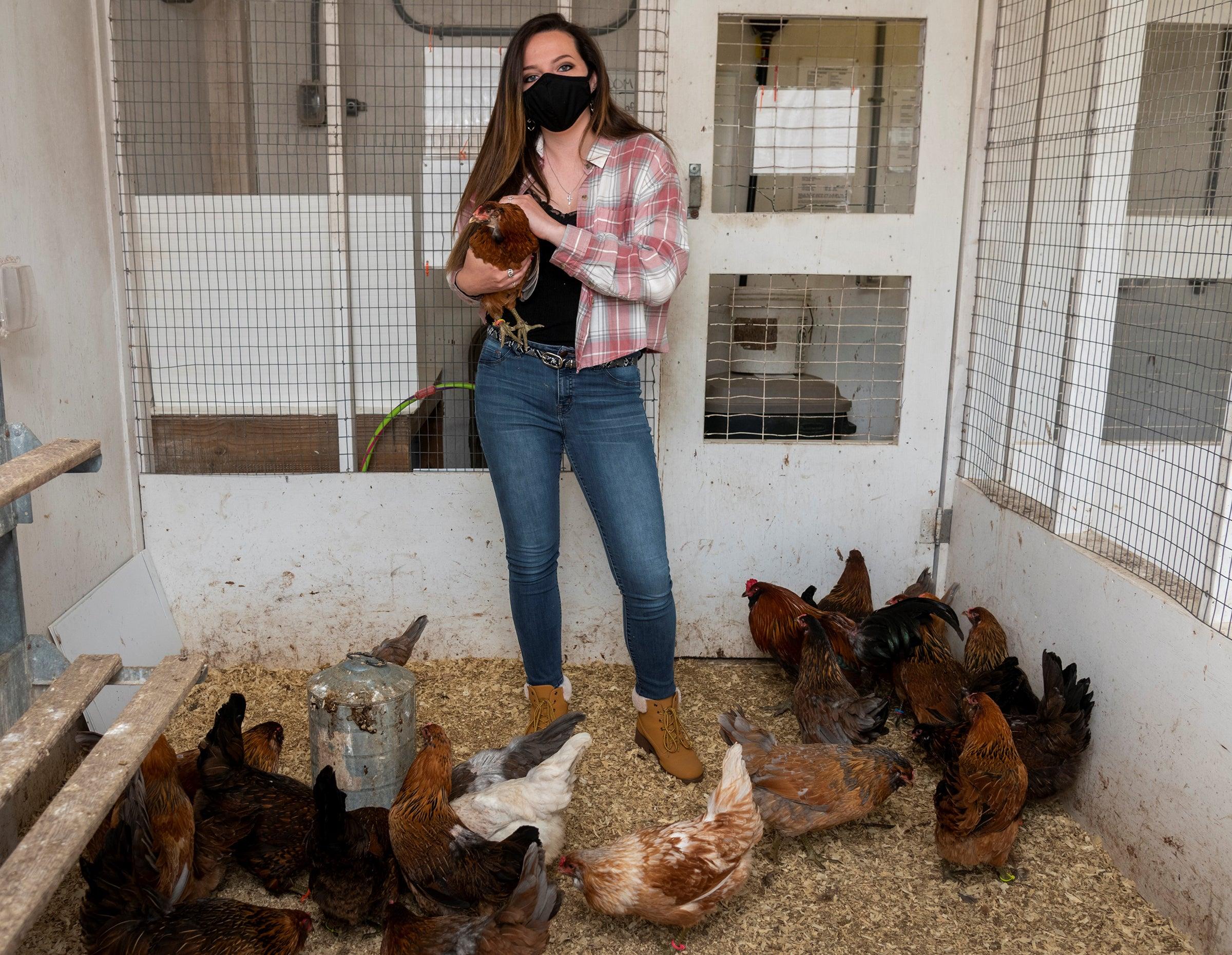 Jessica Weidemann with chickens