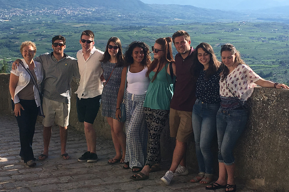 Professor Pisa and students pose in the medieval town of Guardia Sanframondi in the province of Benevento during a 2017 study abroad trip to Naples
