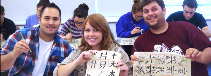 Students show Chinese characters