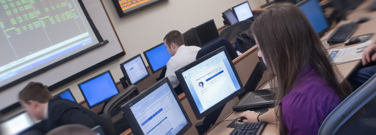 Students in the College of Business trading room.