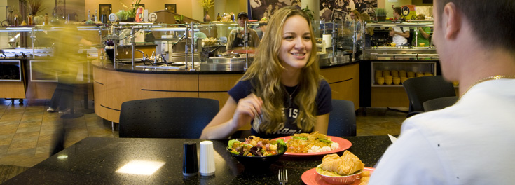 Two URI students eating in the Mainfare dining hall at Hope Commons