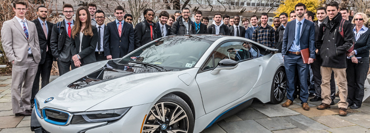 students surrounding BMW at IEP