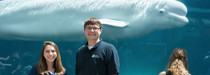 Student researchers with Beluga whale