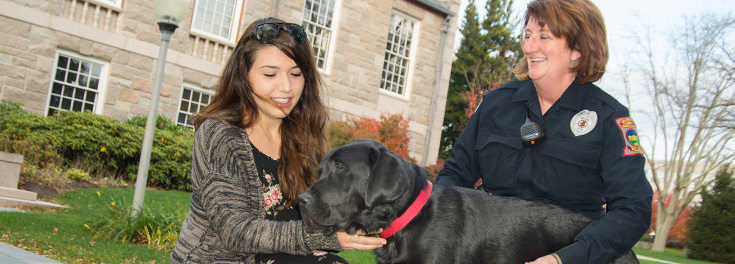 Sgt. Vieira and Figaro with a student
