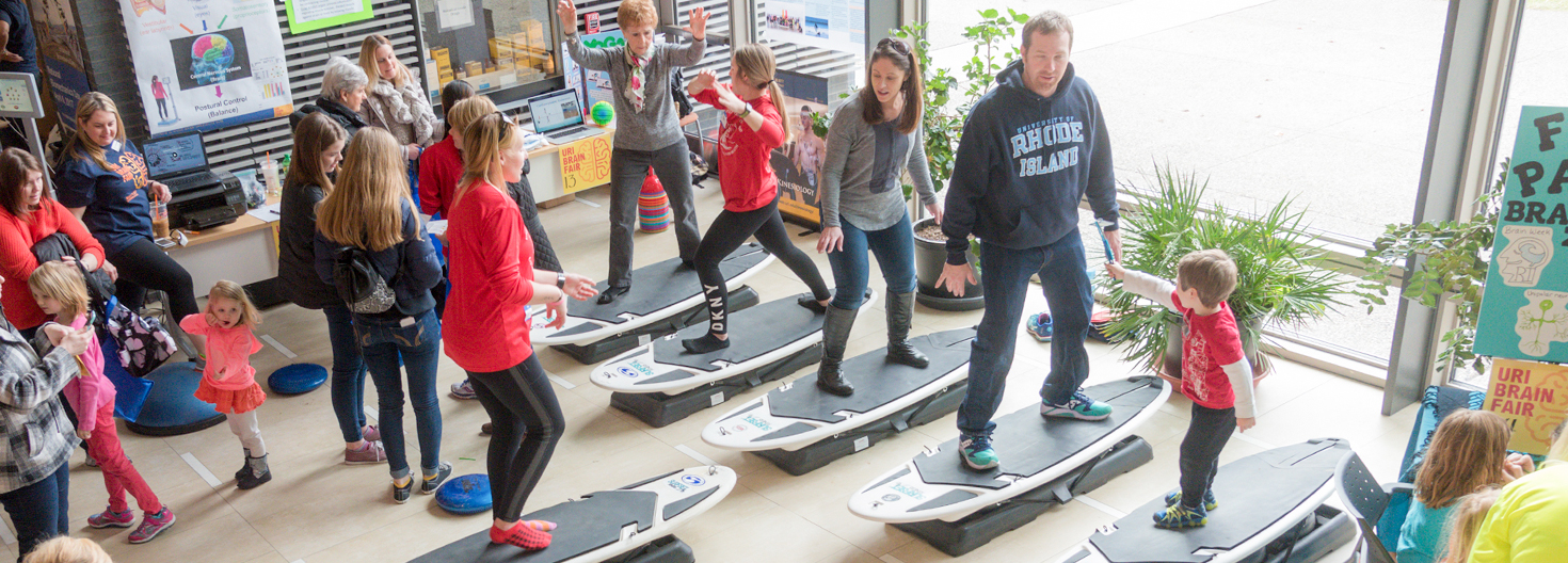 students and families participating in surfing exercise at Brain Fair