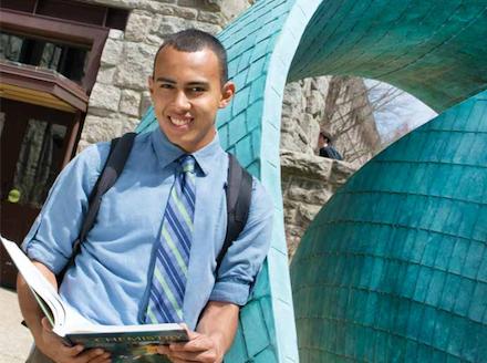 Wilfredo Tangui '18, Fulbright recipient, in front of Lippitt Hall, Kingston