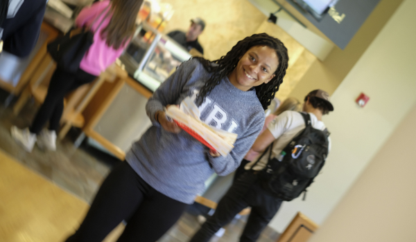 A student getting a meal at Hope Commons