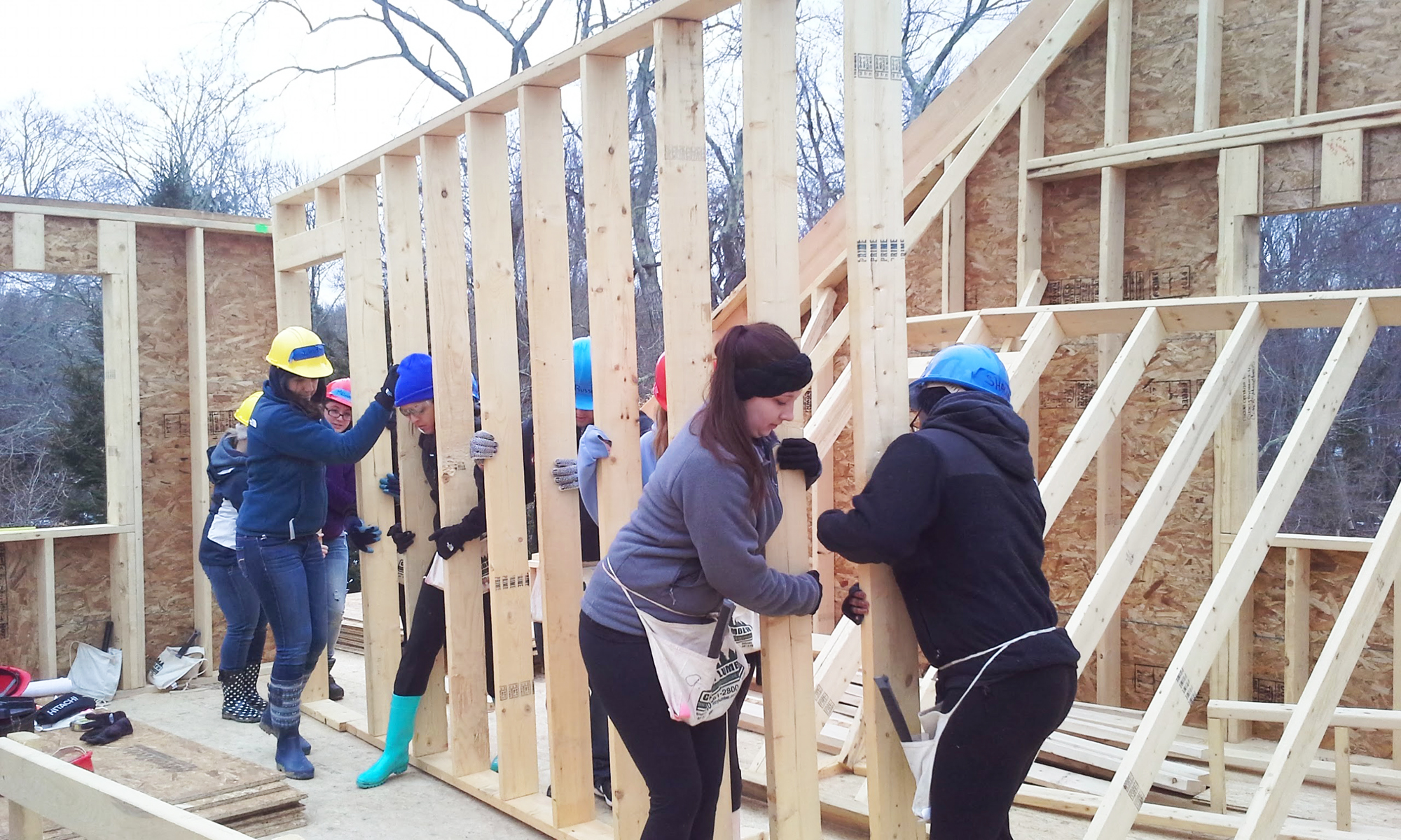 students erecting a wall